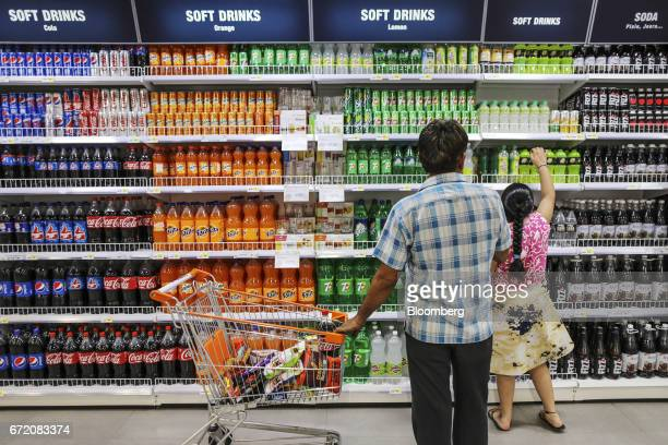 Customers browse soft drinks at a Big Bazaar hypermarket operated by Future Retail Ltd in Mumbai India on Sunday April 16 2017 Future Retail India's...