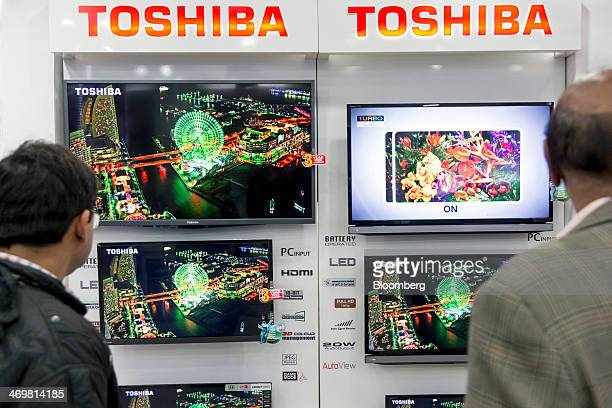 Customers browse televisions at a Toshiba Corp store in Nehru Place IT Market a hub for the sale of electronic goods and computer accessories in New...