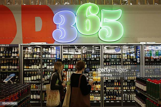 Customers browse the craft beer selection on the opening day of the 365 by Whole Foods Market store in the Silver Lake neighborhood of Los Angeles...