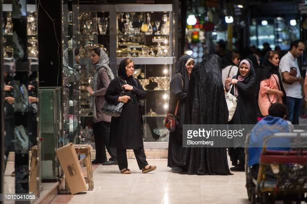 Customers browse the stores inside the Grand Bazaar in Tehran Iran on Monday Aug 6 2018 Irans central bank acting on the eve of US sanctions scrapped...