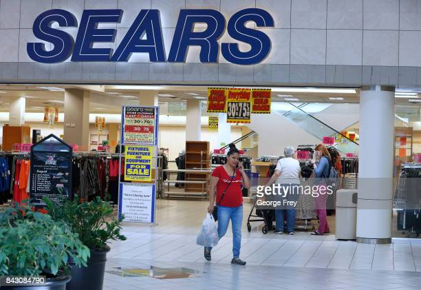 Customers browse through merchandise that is highly discounted in the Sears store on September 5 2017 in Provo Utah The Sears store which has been...