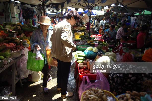 A customers browses fruit and vegetables displayed for sale at a market stall in Ho Chi Minh City Vietnam on Wednesday June 20 2018 For decades...