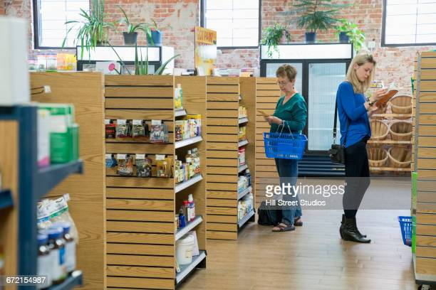 customers browsing in nutrition store - health food shop stock pictures, royalty-free photos & images