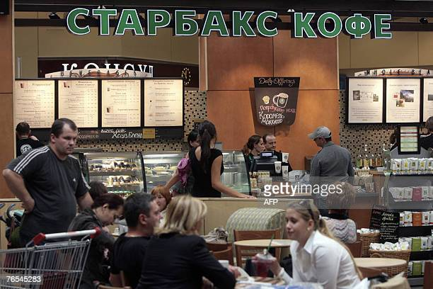 Customers buy and drink coffee on opening day of Russia's first Starbucks in Moscow, 06 September 2007. Starbucks is hoping cash in on the Russian...