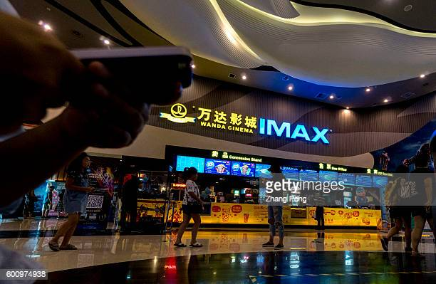 Customers buy film ticket in a Wanda IMAX cinema Wanda Cinema Line Chinas biggest movietheater operator is expanding cooperation with US company...