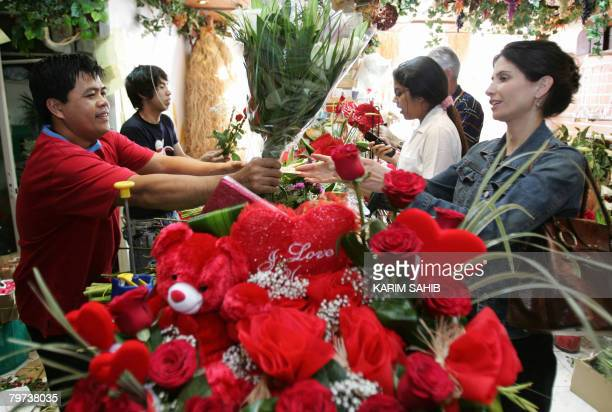 Customers buy flowers and valentine's gifts at a florist in Dubai on 13 February 2008 True to tradition Saudi Arabia's religious police are zealously...