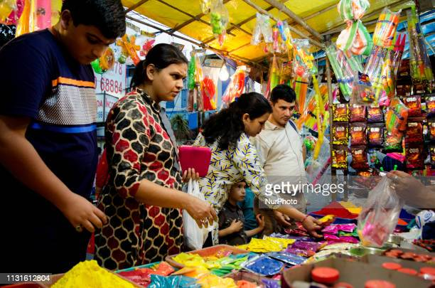 Customers buy Holi celebration items from a market in Kolkata India on 19 March 2019 The Hindu Festival of Holi also known as Festival of colours...