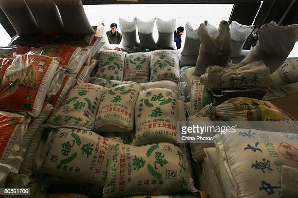 Customers buy rice at a farm product market on April 8 2008 in Wuhan of Hubei Province China According to the National Development and Reform...
