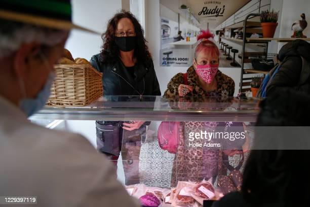Customers buy vegan meat alternatives on opening day at Rudy's Vegan Butcher on November 1, 2020 in London, England. The team behind Rudy's Vegan...