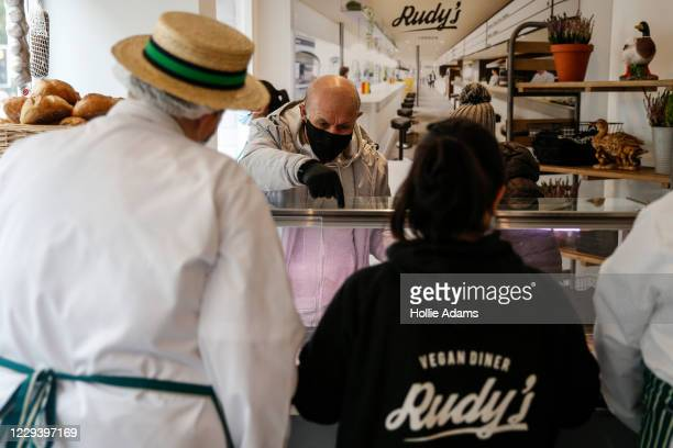 Customers buy vegan meat-free alternatives on opening day at Rudy's Vegan Butcher on November 1, 2020 in London, England. The team behind Rudy's...