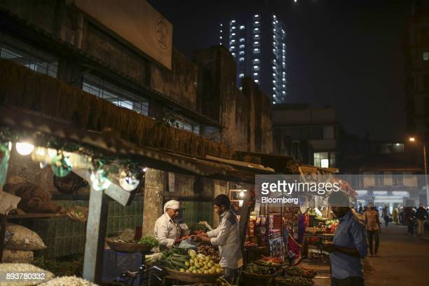 Customers buy vegetables at a stall in Mumbai India on Friday Dec 15 2017 India's inflation surged past the central bank's target bolstering a view...