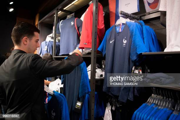 Customers buying France's national football team jersey, at a shop in the Champs Elysees in Paris, on July 11 ahead of the Football World Cup final.