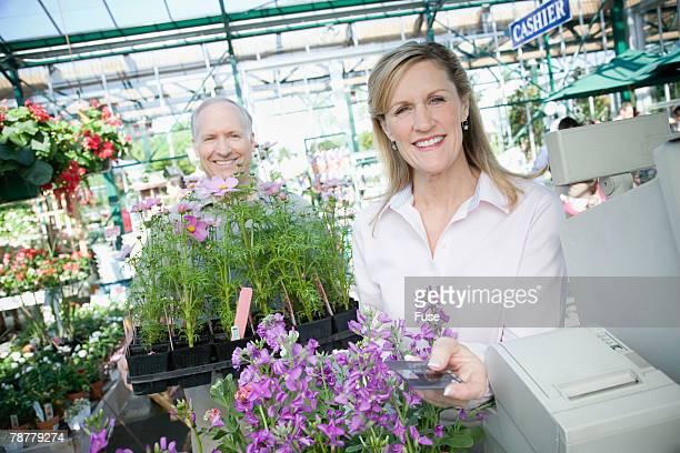 Customers Buying Plants at Nursery