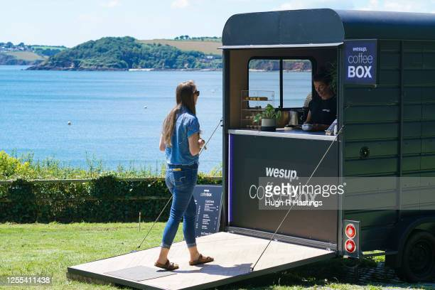 Customers call in at the newly opened Wesup Coffee Box mobile takeaway located by the coast on Cliff Road Pendennis Point on July 10 2020 in Falmouth...