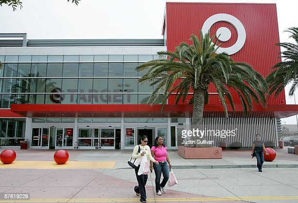 Customers carry bags as they leave a Target store May 15 2006 in Albany California Target announced a 12 percent rise in profit in its quarterly...