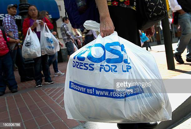 Customers carry Ross Stores Inc. Shopping bags in San Francisco, California, U.S., on Tuesday, Aug. 14, 2012. Ross Stores Inc. Is expected to release...