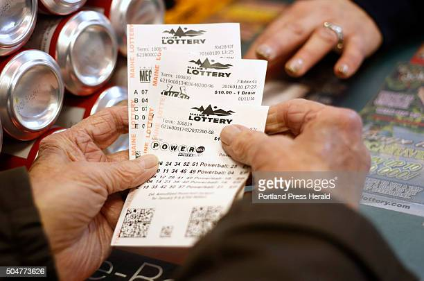 A customers cashing in lottery tickets at Broadway Variety in South Portland on Tuesday January 12 2016