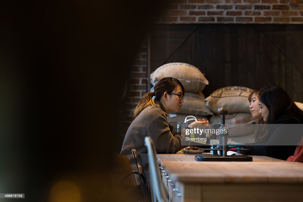 Customers chat at the Terarosa Coffee shop in Seoul, South Korea, on Tuesday, Feb. 4, 2014. South Korea is Asias fastest-growing market for arabica coffee, the mild-tasting beans used in premium blends. Photographer: SeongJoon Cho/Bloomberg via Getty Images