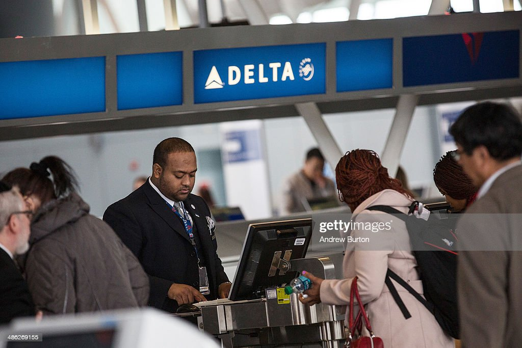Customers check in at Delta's counter at John F. Kennedy Airport on April 23, 2014 in the Queens borough of New York City. Delta released higher-than-expected quarterly earnings today, causing its stock to rise 5%.