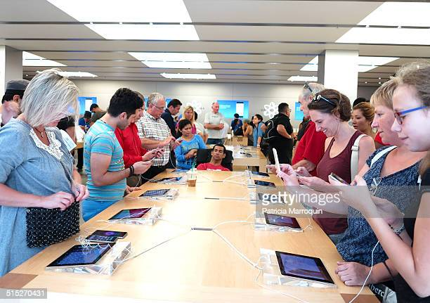 Customers check out the new iPhone 6 models at the Apple Store at Westfield Topanga shopping center in Canoga Park California on September 19 2014