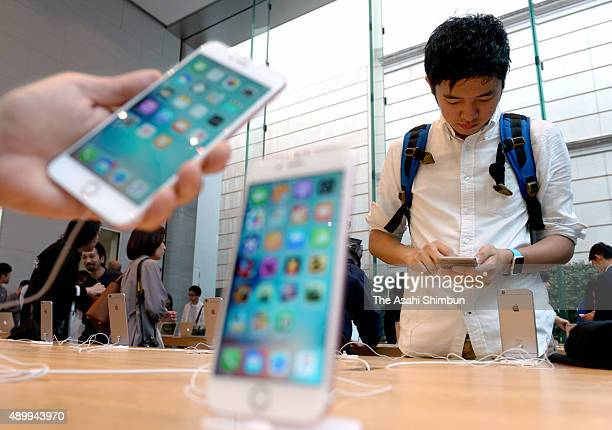 Customers check the new iPhone 6s and 6s Plus at Apple Store Omotesando on September 25 2015 in Tokyo Japan Apple launches the new iPhone 6s and...