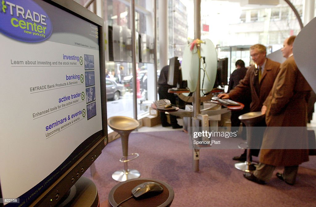 Customers check their stocks on the floor of the new E*Trade