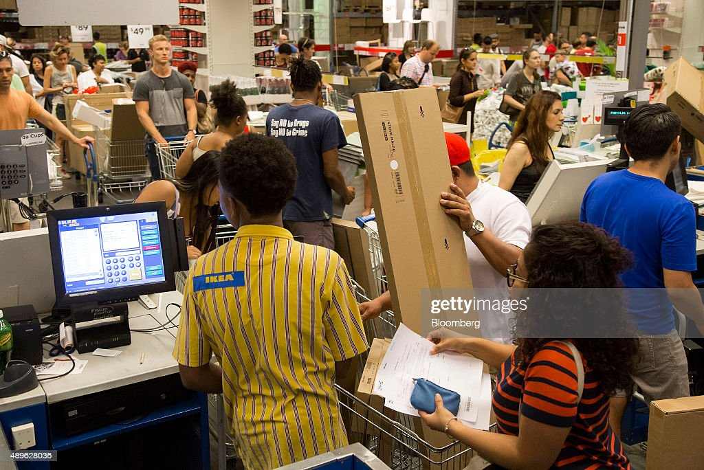 Customers checkout at an Ikea store in the Brooklyn borough of New York, U.S., on Saturday, Sept. 19, 2015. The U.S. Census Bureau is scheduled to release monthly durable goods data on Sept. 24. Photographer: Michael Nagle/Bloomberg via Getty Images