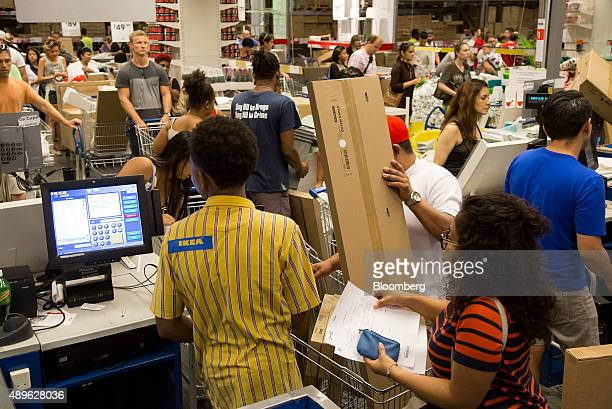 Customers checkout at an Ikea store in the Brooklyn borough of New York US on Saturday Sept 19 2015 The US Census Bureau is scheduled to release...