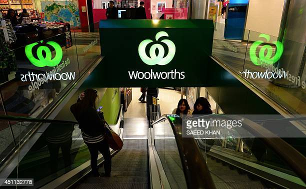 Customers come out from a Woolworths retail shop in Sydney on June 24 2014 South African retail giant Woolworths on June 24 announced a bid to buy...