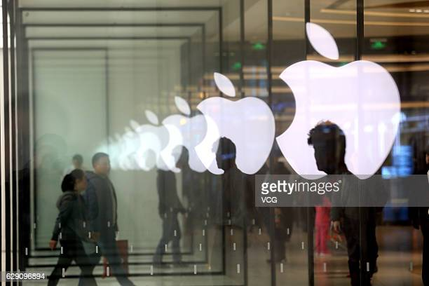 Customers come to the newly opened Apple store on December 10 2016 in Shanghai China Shanghai opened its 7th Apple store on Saturday