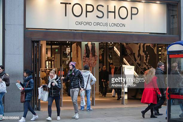 Customers coming out of the Top Shop flagship store Oxford Street London