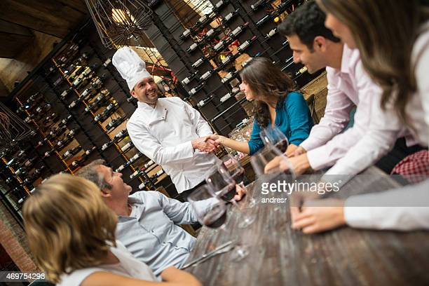 Customers congratulating the chef at a restaurant
