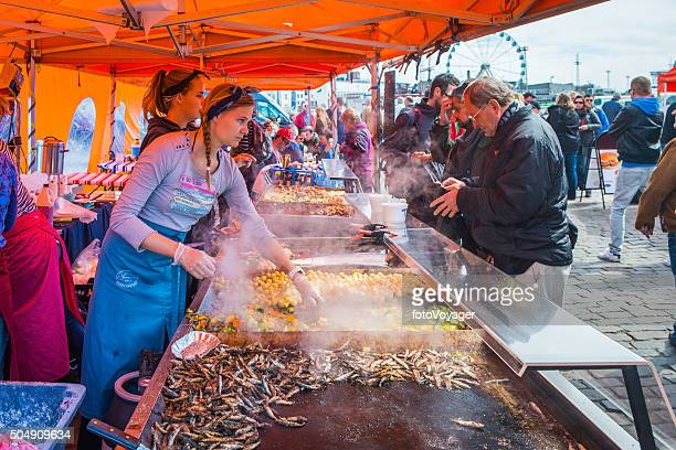 customers cooks busy traditional food stall market square helsinki finland - helsinki stock pictures, royalty-free photos & images