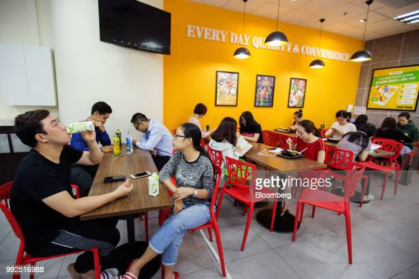 Customers dine and drink at tables in a 7Eleven store in Ho Chi Minh City Vietnam on Wednesday June 20 2018 For decades Vietnamese have shopped...