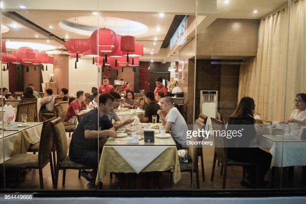 Customers dine at a Chinese restaurant at night in Manila the Philippines on Wednesday May 2 2018 Home prices in the metropolitan Manila area gained...
