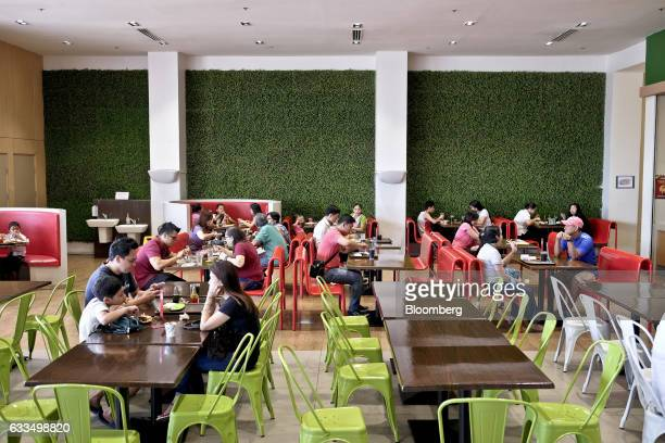 Customers dine at a food court in a CityMall outlet developed by DoubleDragon Properties Corp in Cavite the Philippines Friday Jan 27 2017...