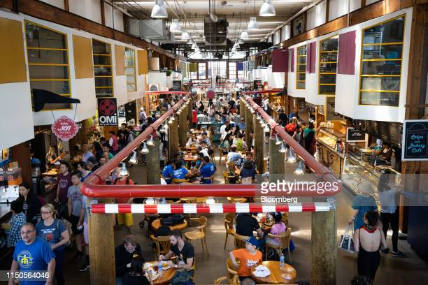 Customers dine at tables inside the Granville Island Public Market in Vancouver British Columbia Canada on Sunday June 2 2019 Statistics Canada is...