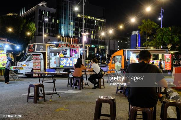 Customers dine at tables on the street next to food trucks in Putrajaya Malaysia on Wednesday Sept 23 2020 Malaysia's Prime Minister Muhyiddin Yassin...