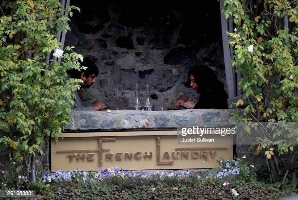 Customers dine at the Michelin-starred restaurant The French Laundry on December 16, 2020 in Yountville, California. The French Laundry, owned by...