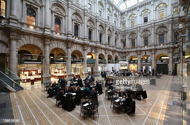 Customers dine in the lobby area restaurant at the Royal Exchange luxury shopping and dining arcade in London UK on Wednesday Feb 8 2012 UK shopprice...