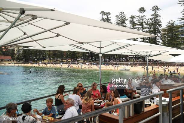 Customers dine in the outdoor section of a restaurant at Manly Beach in Sydney Australia on Friday Jan 5 2018 The Australian Bureau of Statistics is...