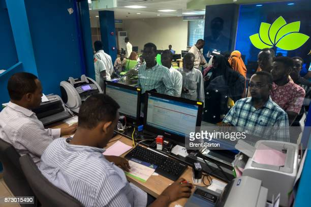 Customers doing brisk business inside Premier Bank in Mogadishu This modern bank has 6 branches in Mogadishu and 1 in Hargeysa 70% of all banking is...