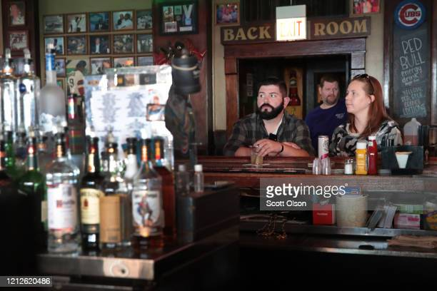 Customers eat and drink at Sluggers, a family-owned sports bar and grill in the shadow of Wrigley Field, on March 15, 2020 in Chicago, Illinois....