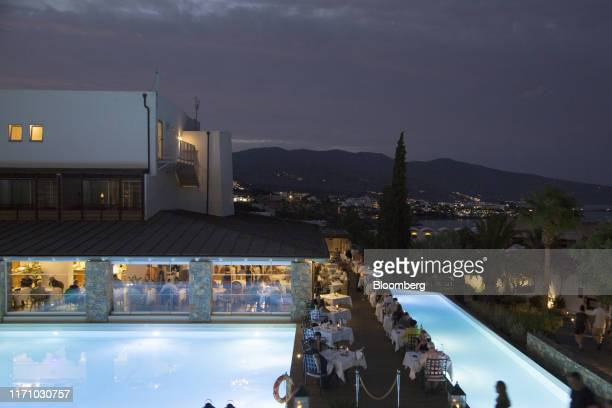 Customers eat and drink in a restaurant and pool bar at Elounida village resort on the island of Crete, Greece, on Tuesday, Sept. 24, 2019. Like...