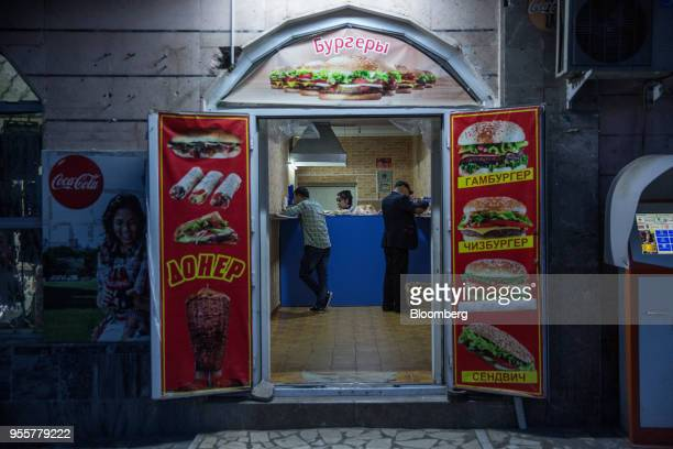 Customers eat at a fastfood restaurant in Dushanbe Tajikistan on Saturday April 21 2018 Flung into independence after the Soviet Union collapsed in...