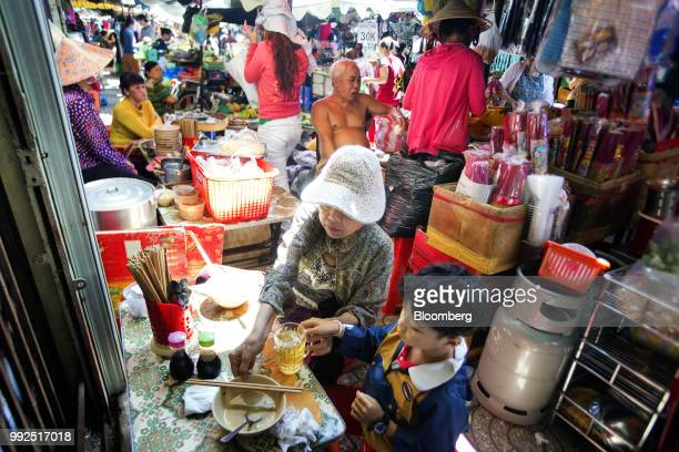 Customers eat at a market in Ho Chi Minh City Vietnam on Wednesday June 20 2018 For decades Vietnamese have shopped snacked and hung out at the...