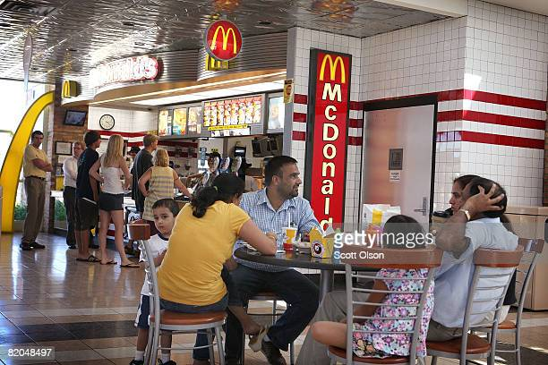 Customers eat at a McDonald's restaurant July 23 2008 in Schiller Park Illinois McDonald's Corp the world's largest restaurant chain today posted a...