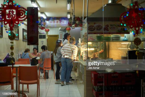 Customers eat at a restaurant in the streets of Manila's Chinatown on September 16, 2021 in Manila, Philippines. The Philippines capital is yet again...