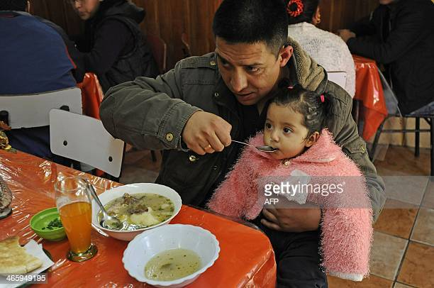 Customers eat Cardan a soup made with phallus and testicles of bulls at the Casa de Oro restaurant in La Paz on January 18 2014 For Bolivian people...