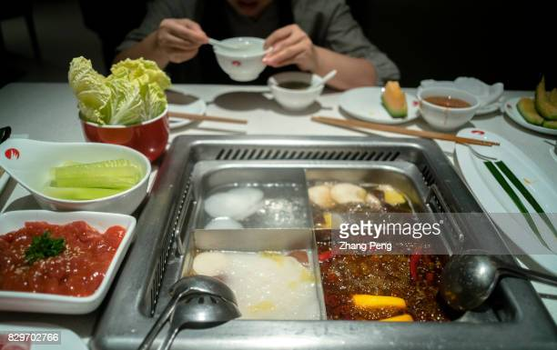 Customers eat hotpot in a Haidilao restaurant Haidilao is China's most famous hotpot catering brand known its delicate service and used as case study...